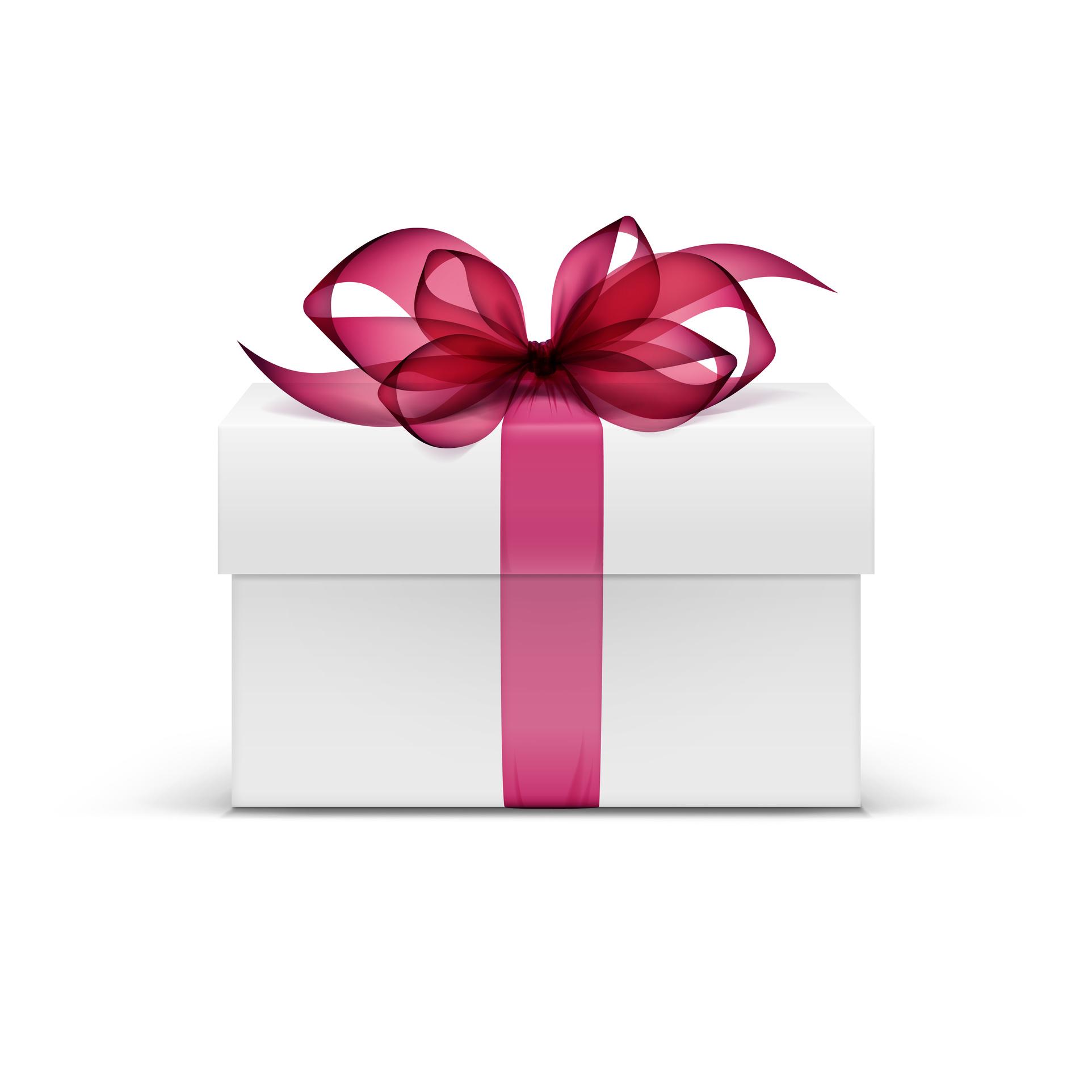 Weißes, rechteckiges Geschenk mit rötlicher Schleife anlässlich des 18. Geburtstages von Häcker & Partner